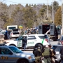 Officer, 3 others killed in Wisconsin shootings; suspect in custody