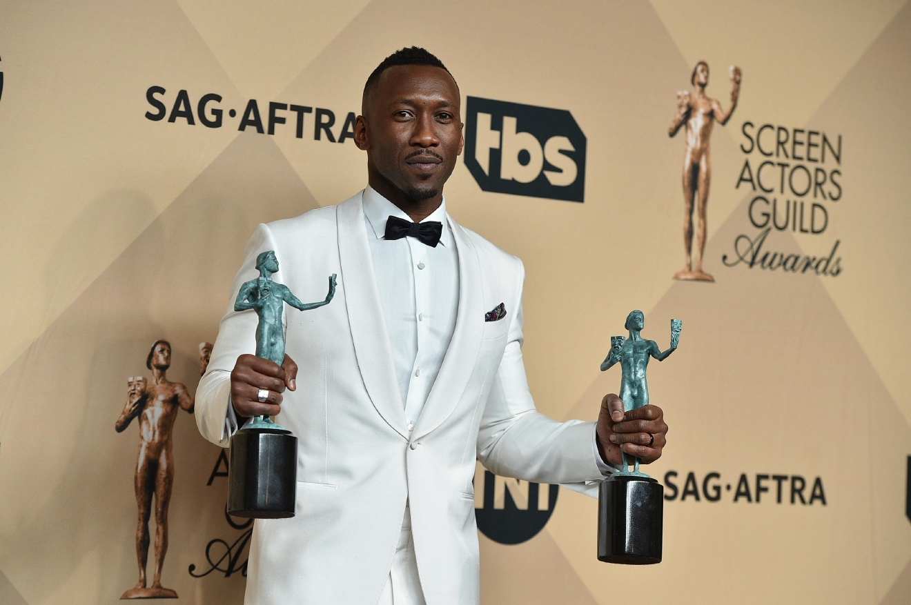 "Mahershala Ali poses in the press room with the awards for outstanding performance by a male actor in a supporting role for ""Moonlight"" and outstanding performance by a cast in a motion picture for ""Hidden Figures"" at the 23rd annual Screen Actors Guild Awards at the Shrine Auditorium & Expo Hall on Sunday, Jan. 29, 2017, in Los Angeles. (Photo by Jordan Strauss/Invision/AP)"