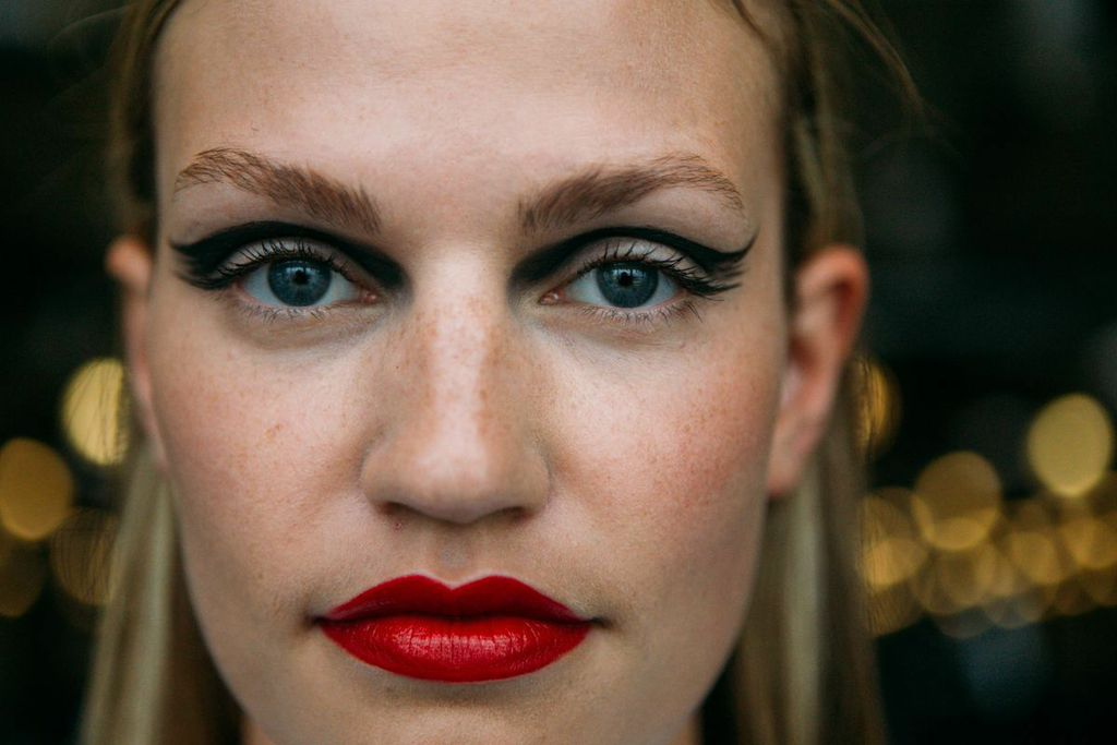 Dark, dramatic eye makeup paired with richly pigmented lip color is Fall 2014's number one trend for the season. (Image: Joshua Lewis)