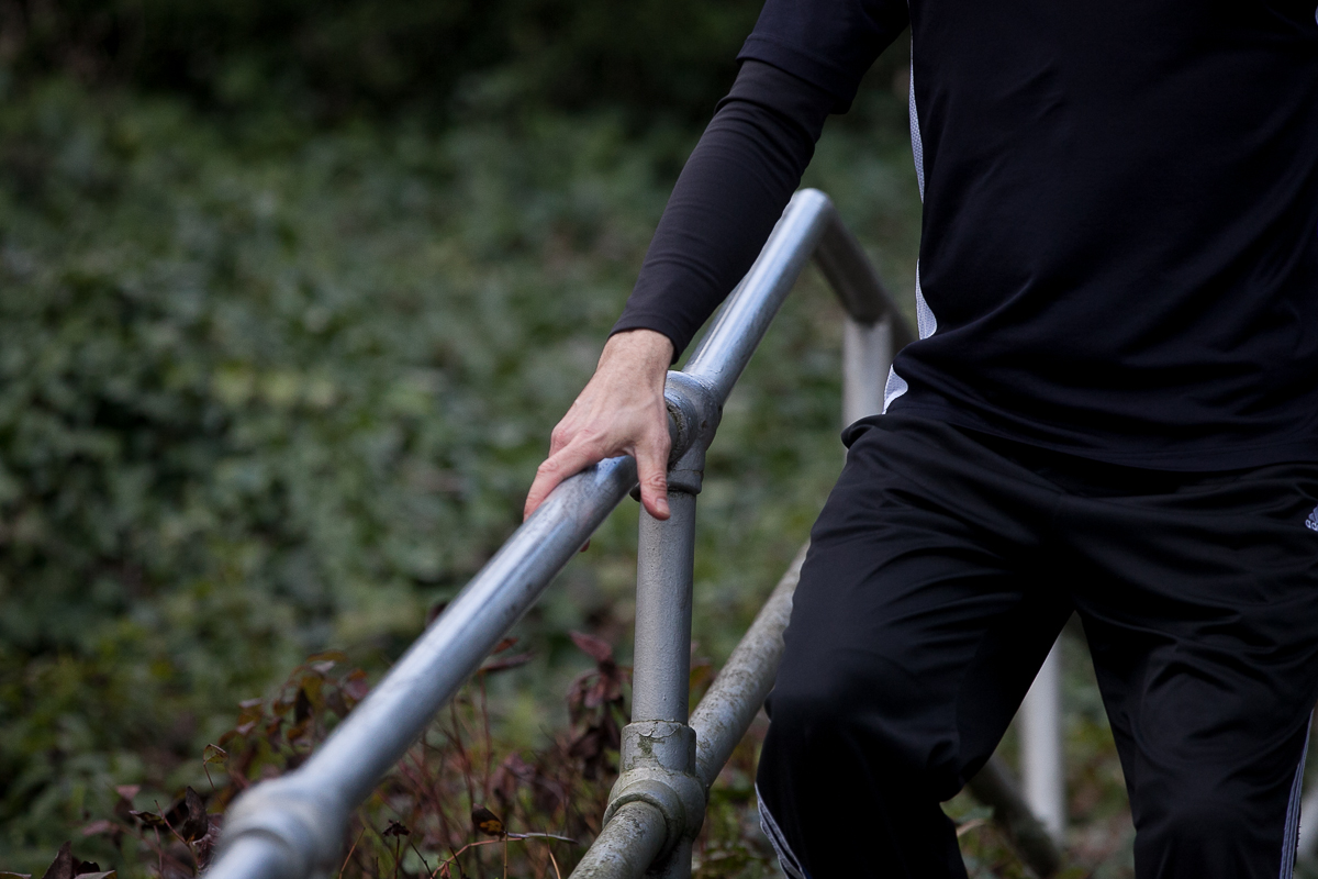 If you're working out outside, and have to go down stairs, make sure you use different descending techniques like going down pigeon-toed, duck footed, or sideways. This distributes weight more evenly throughout your muscles and will help with soreness the next day. (Image: Joshua Lewis / Seattle Refined)