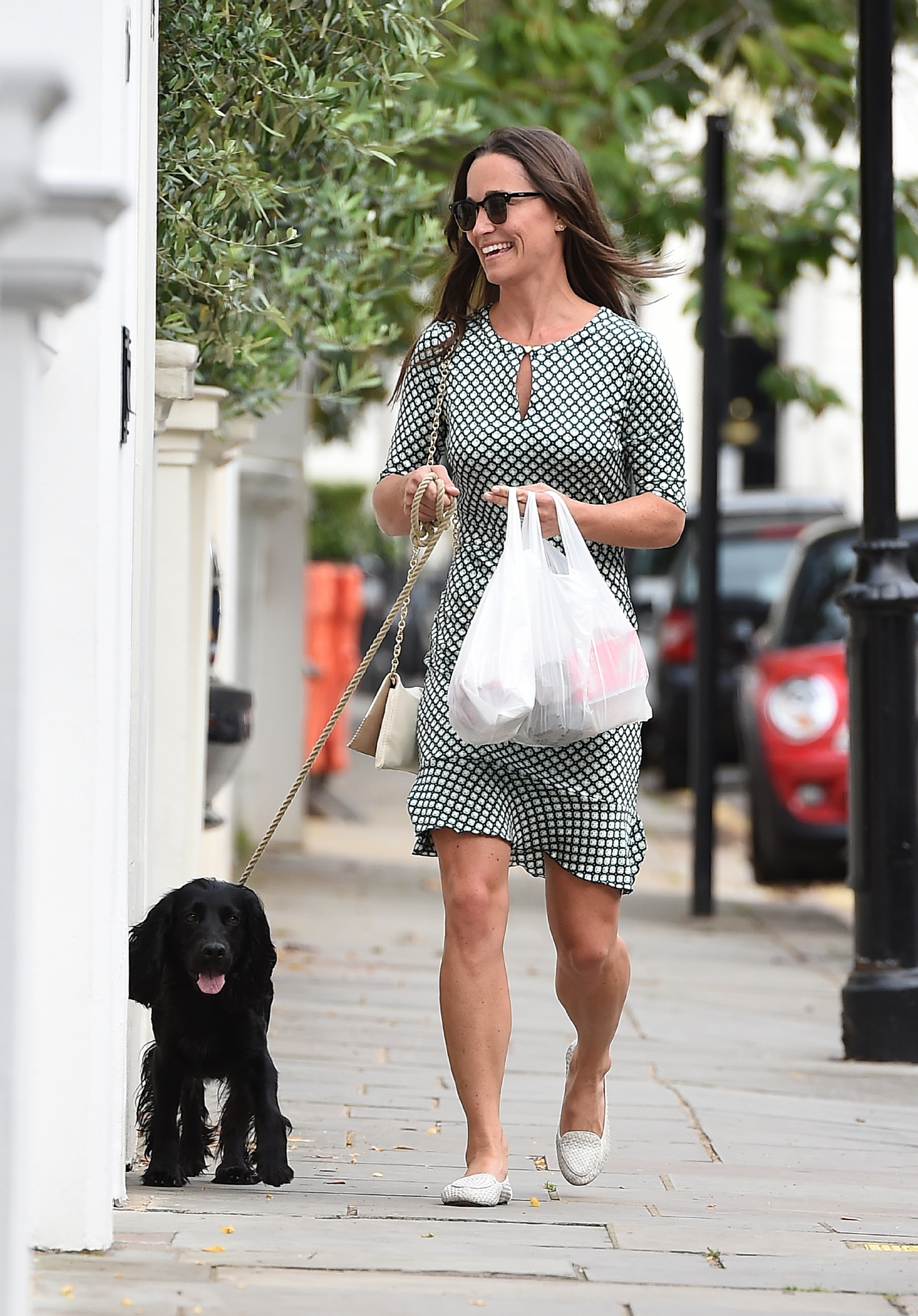 Pippa Middleton takes her dog for a walk in Chelsea, and picks up some shopping on the way. She was sporting her £200,000 engagement ring as she smiled at waiting photographers  Featuring: Pippa Middleton Where: London, United Kingdom When: 21 Jul 2016 Credit: Will Alexander/WENN.com