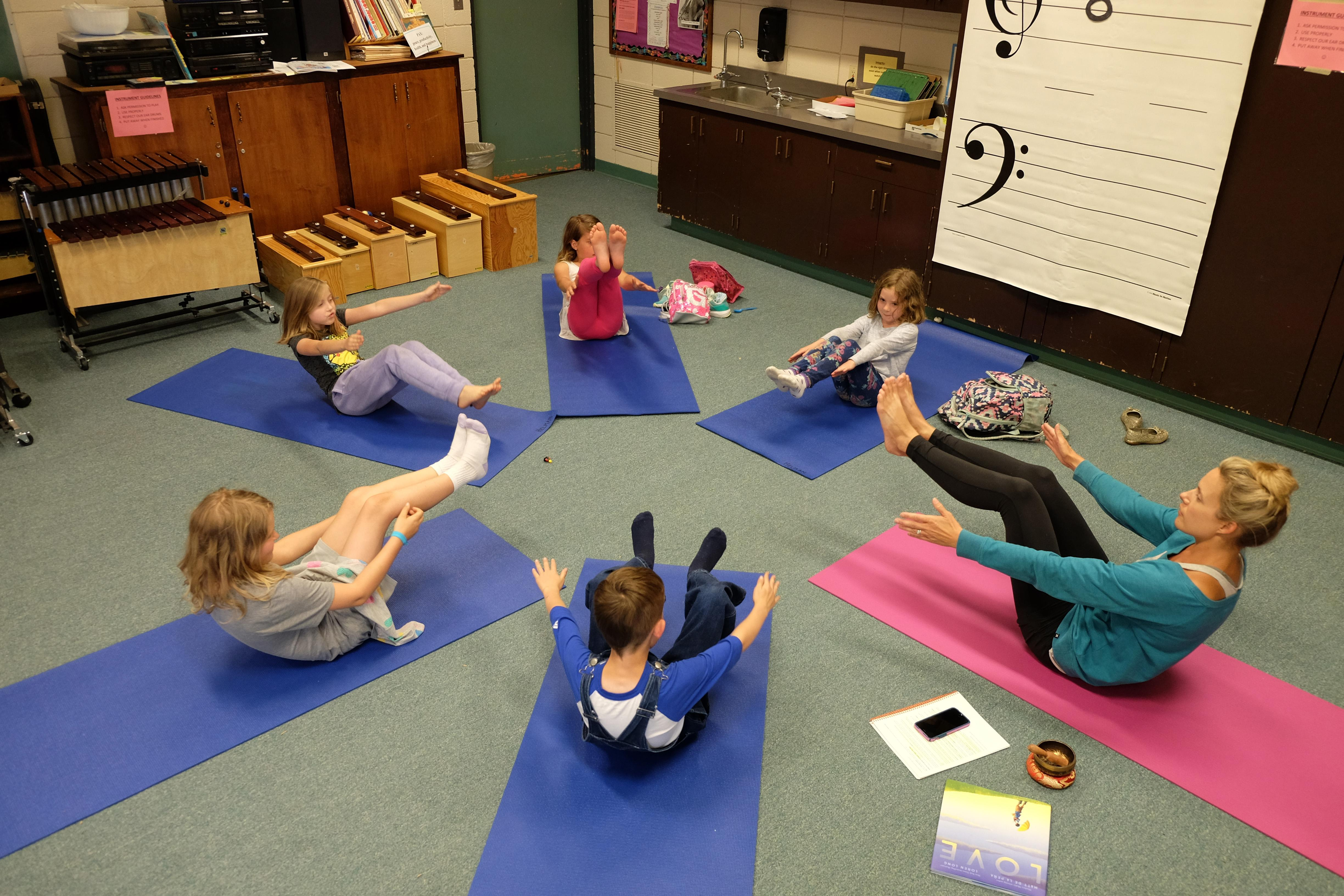 "Photo by Caitlin FowlkesStudents play a game of ""yogi says"" in the After School Enrichment Program yoga course."