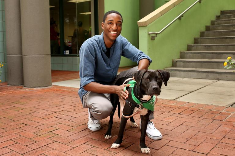 Kendall is a 27-year-old web developer from Baltimore. His ideal first date would be happy hour and a walk through the park. // Hailey is an 8-month-old black lab mix. Hailey needs to go to a home with a dog that is equal in size or bigger than her. She is up for adoption at Lucky Dog Animal Rescue. (Amanda Andrade-Rhoades/DC Refined)