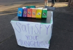 Girl Scout sells cookies outside Portland pot shop.jpg