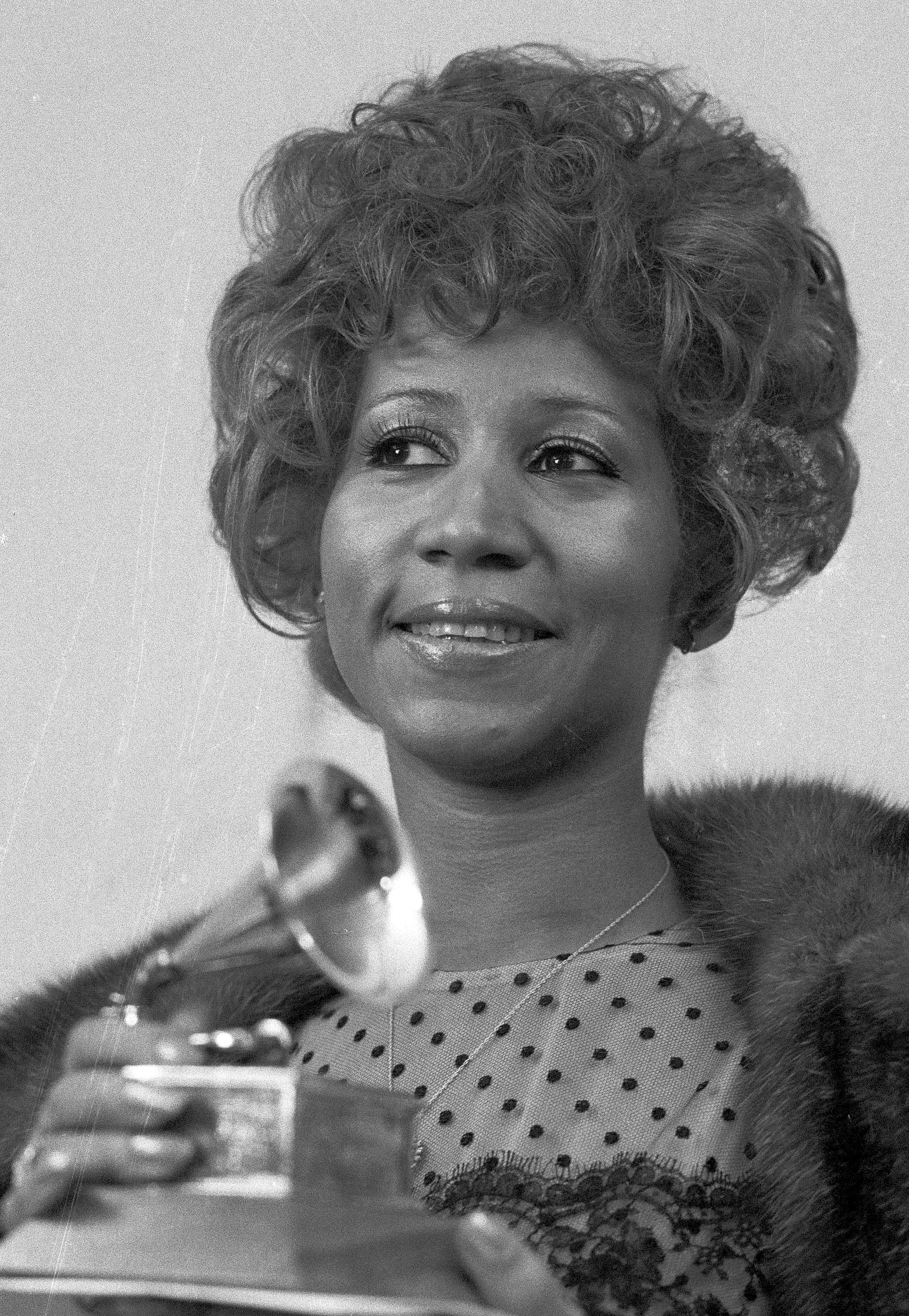 "FILE - In this March 13, 1972 file photo, Aretha Franklin holds her Grammy Award for Best Rhythm and Blue performance of the song ""Bridge Over Troubled Waters,"" in New York. Franklin died Thursday, Aug. 16, 2018 at her home in Detroit.  She was 76. (AP Photo/Dave Pickoff, File)"