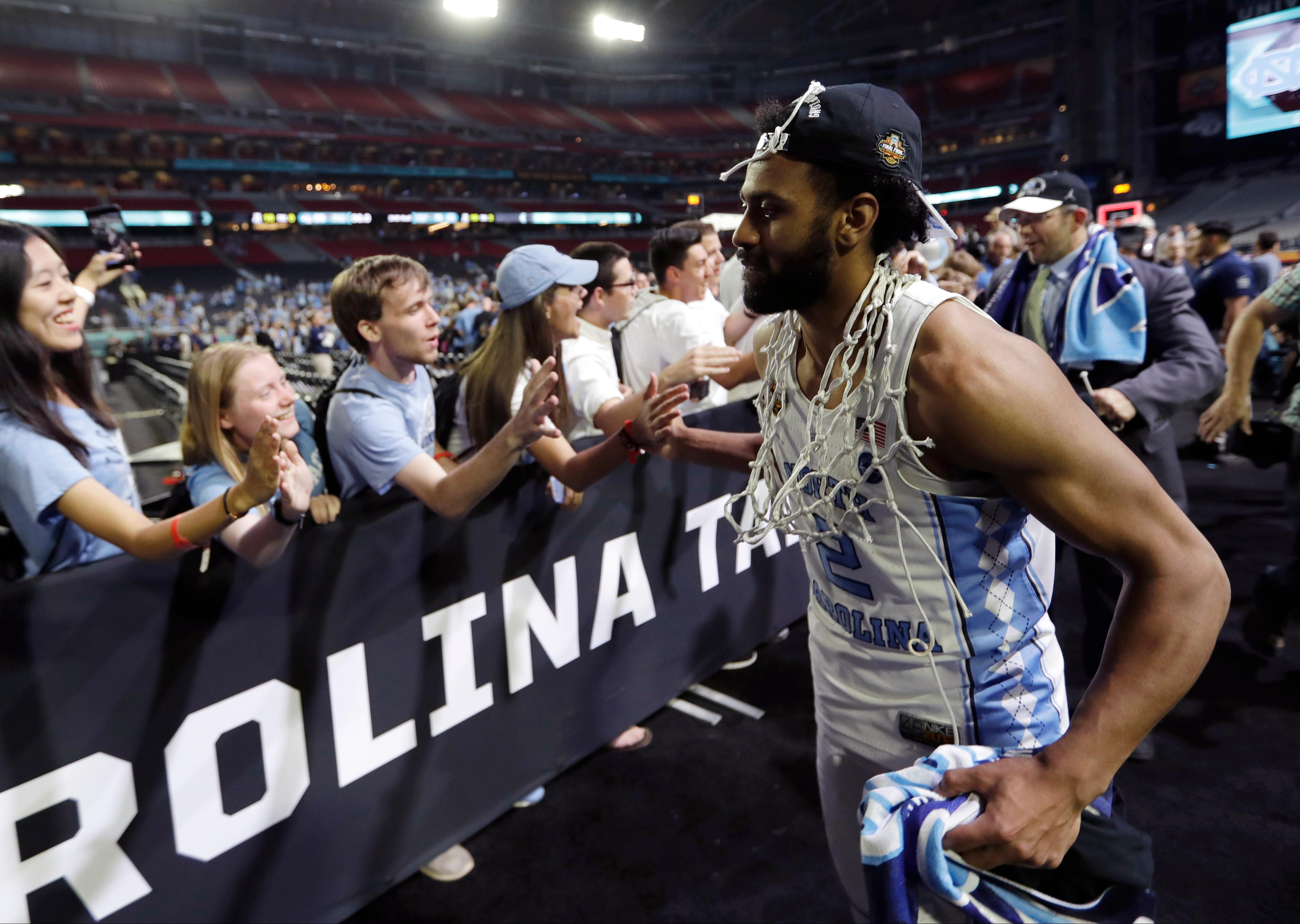 FILE - In this April 3, 2017, file photo, North Carolina guard Joel Berry II celebrates with fans after the championship game against Gonzaga at the Final Four NCAA men's college basketball tournament in Glendale, Ariz. Berry was named the most outstanding player of the Final Four after scoring 22 points and dishing out six assists with only one turnover in the Tar Heels' NCAA championship game victory over Gonzaga. He did all that despite playing the NCAA Tournament with a pair of sprained ankles. (AP Photo/David J. Phillip, File)