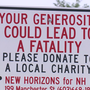 Signs ask drivers give to charity, not panhandlers