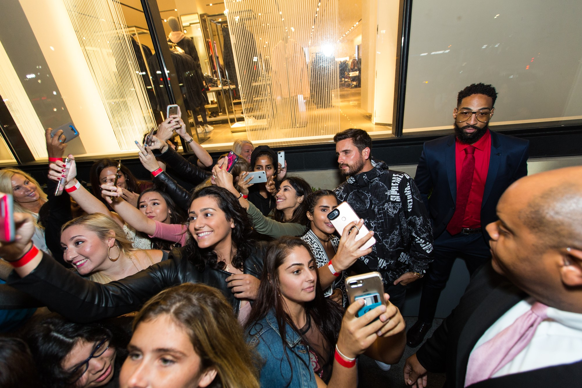 Disick posed on the red carpet just outside the store and took photos with excited fans before heading inside. (Image: John Robinson)