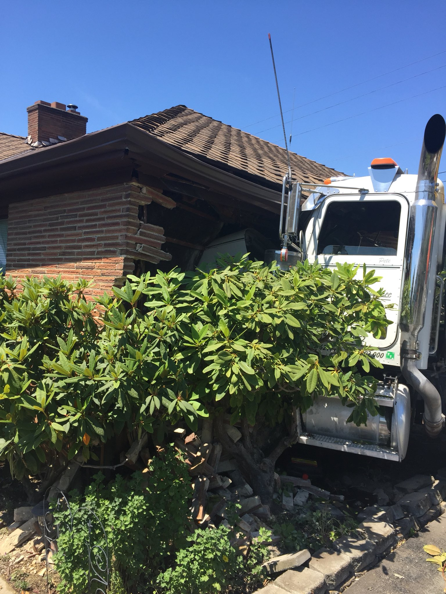 A semi truck without a driver crashed into a home in Edmonds Monday, June 18, 2018.{ }(Photo: South Snohomish County Fire)