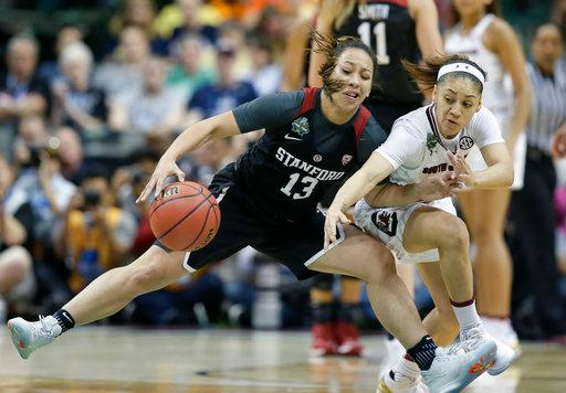 Stanford guard Marta Sniezek (13) and South Carolina guard Bianca Cuevas-Moore (1) scramble for a loose ball during an NCAA college basketball game in the semifinals of the women's Final Four, Friday, March 31, 2017, in Dallas. (AP Photo/LM Otero)