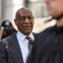 Bill Cosby ordered to stand trial in decade-old sex case
