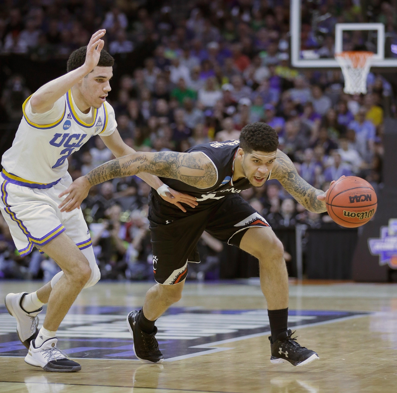 Cincinnati guard Jarron Cumberland, right, drives against UCLA Lonzo Ball during the first half of a second-round game of the NCAA men's college basketball tournament in Sacramento, Calif., Sunday, March 19, 2017. (AP Photo/Rich Pedroncelli)