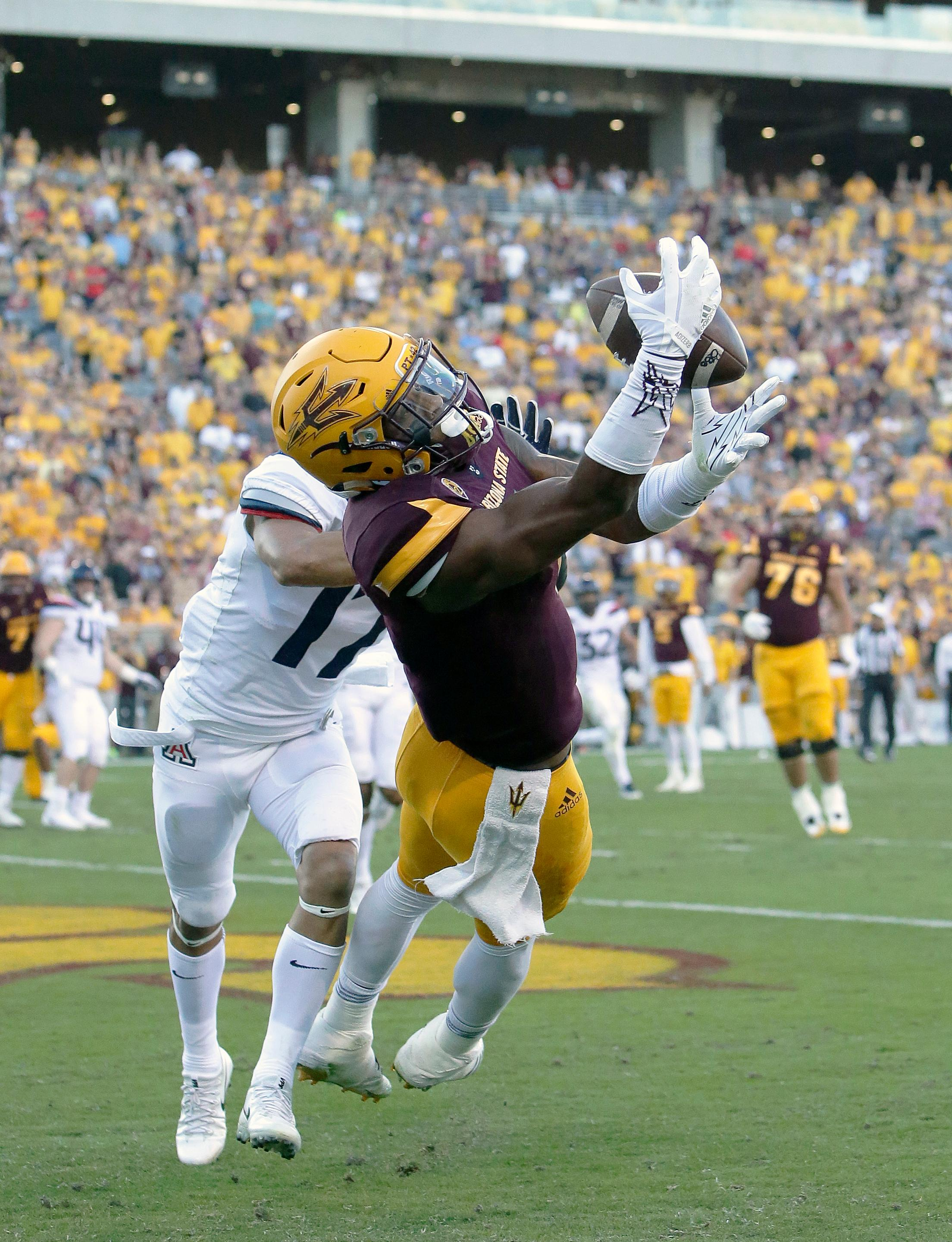 FILE - In this Nov. 25, 2017, file photo, Arizona State wide receiver N'Keal Harry (1) catches a touchdown pass in front of Arizona cornerback Jace Whittaker in the second half during an NCAA college football game, in Tempe, Ariz. Harry was selected to the AP All-Conference Pac-12 team announced Thursday, Dec. 7, 2017. (AP Photo/Rick Scuteri, File)