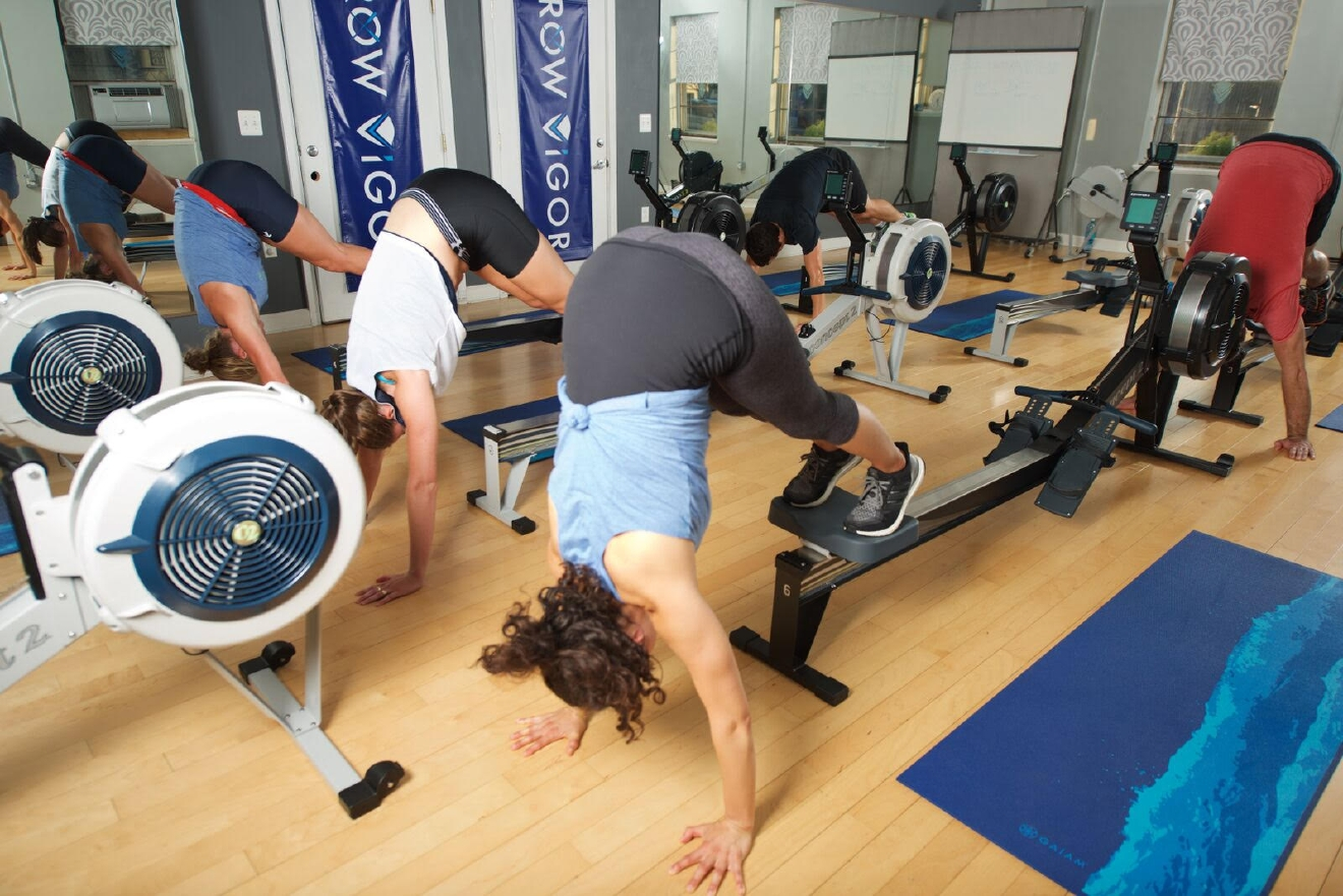 workouts combine the full-body, high-intensity benefits of rowing with a results-driven, small group training format. Each class includes rowing intervals punctuated with a variety of weight bearing exercises for maximum calorie burn and strength building, all set to high-energy music. (ROWViGOR)