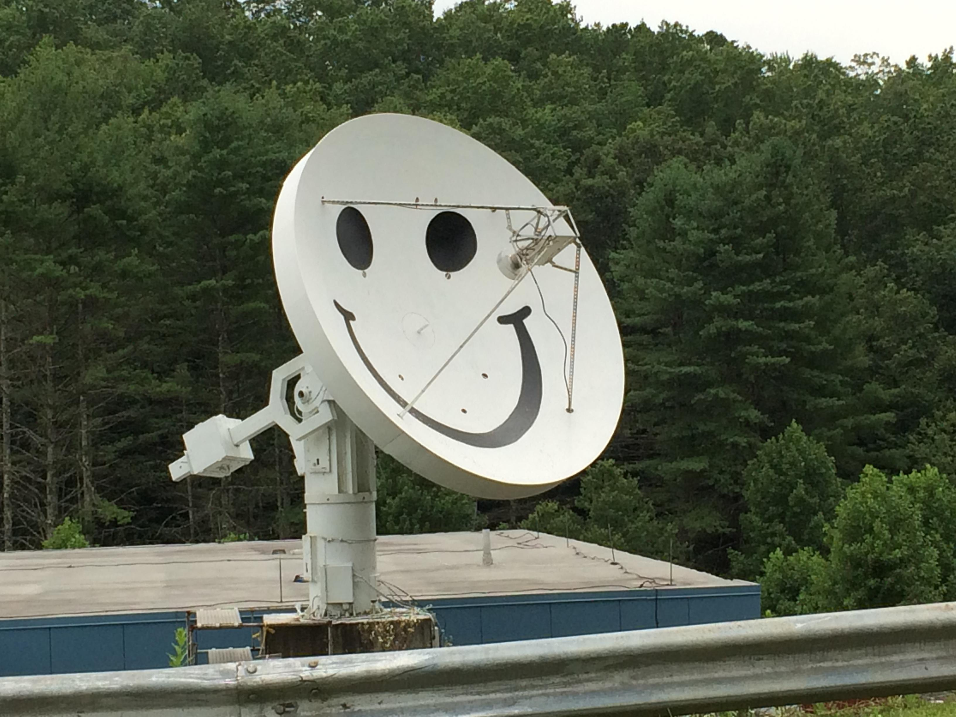 Smiley, the 4.6 meter radio telescope, greets viewers as they drive onto P.A.R.I.'s campus. (Photo credit: WLOS Staff)