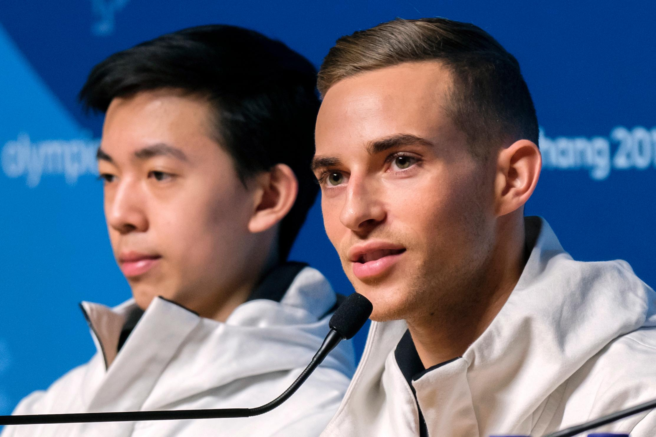 "In this Tuesday, Feb. 13, 2018 photo, United States figure skaters Vincent Zhou, left, and Adam Rippon answer questions during a press conference at the 2018 Winter Olympics in Pyeongchang, South Korea. Food is a big deal for Olympians. The U.S. team has its own chefs and dietitians, as well as two ""nutrition centers"" at the Winter Olympics. Zhou said he needs a lot of carbs, ""before, between and after sessions,"" to fend off fatigue. While Rippon said sheer abundance can be a danger for athletes.  (AP Photo/J. David Ake)"