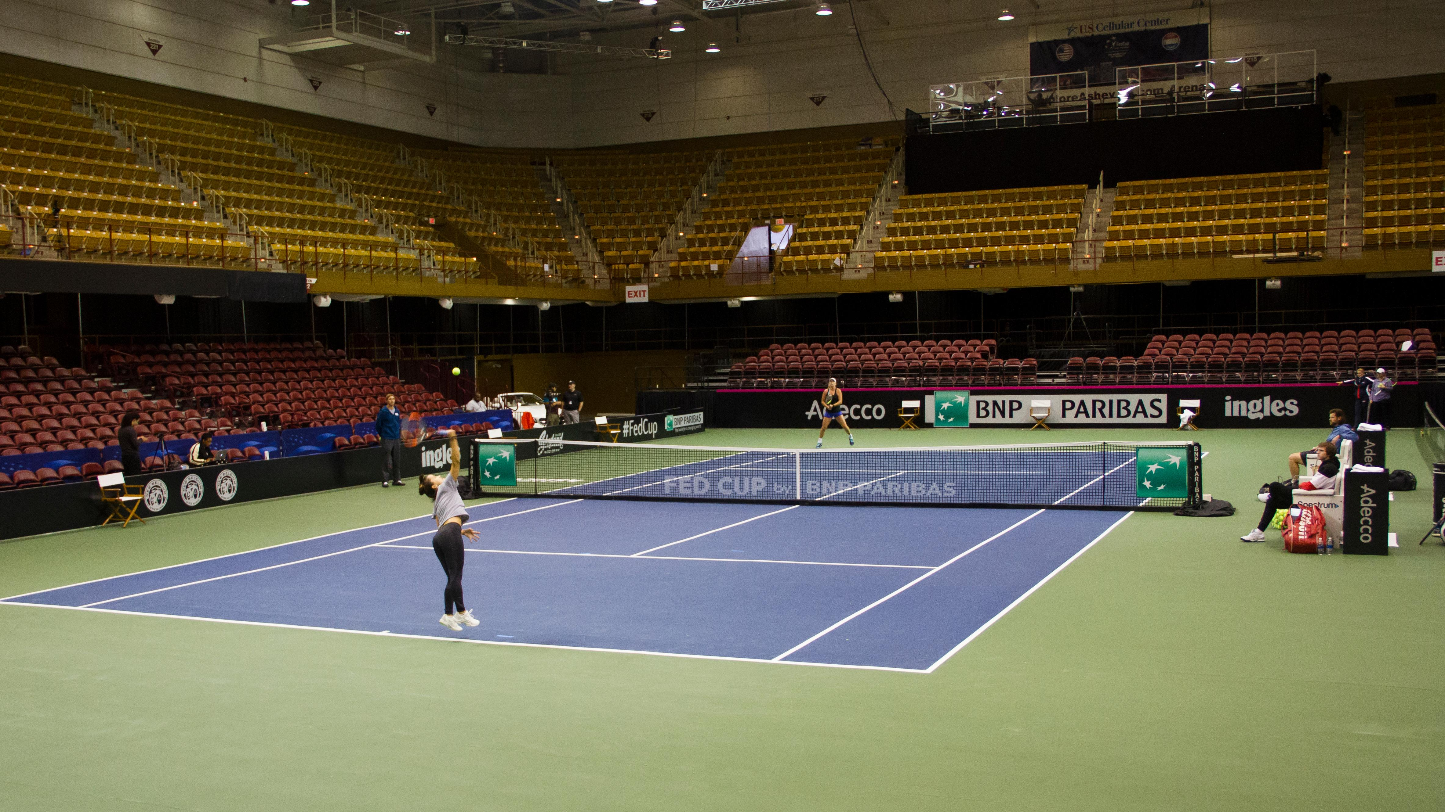 Lauren Davis and CoCo Vandeweghe practice at the US Cellular Center on Feb. 7, 2018, ahead of the Fed Cup. (Photo credit: WLOS Staff)