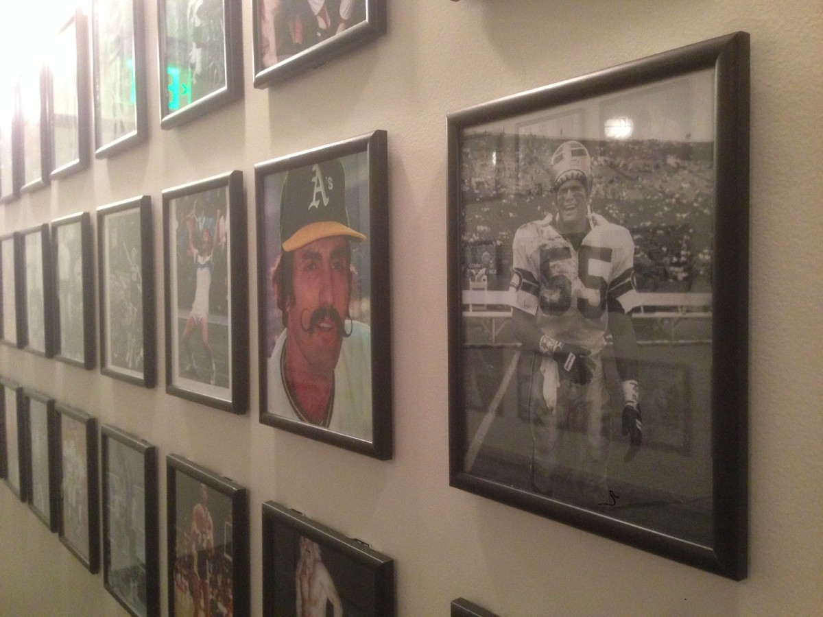 Heading towards the restrooms, pictures of varying levels of athletes line the walls. (Image: Sarah Lawer)