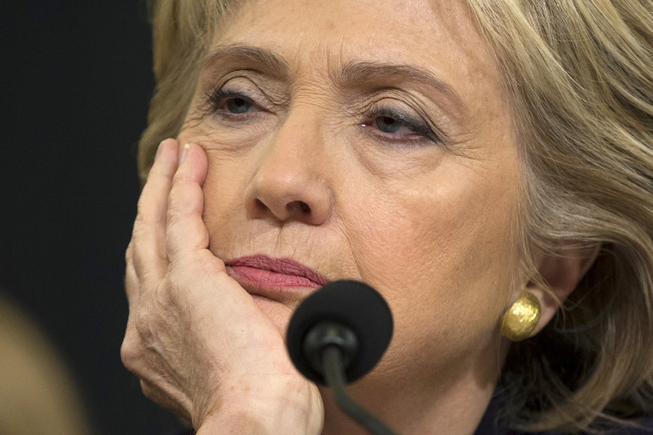In this Oct. 22, 2015 file photo, Democratic presidential candidate, former Secretary of State Hillary Clinton listens while testifying on Capitol Hill in Washington before the House Benghazi Committee. (AP Photo/Evan Vucci, File)