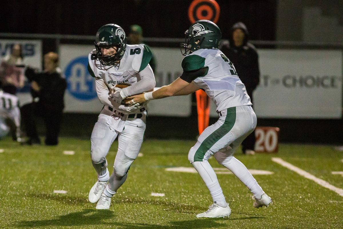 West Salem wide receiver Jacob Denning (#5) receives a handoff from quarterback Grant Thies (#3). On a rainy Monday evening Sheldon defeated West Salem 41-7 at home. The game had been postponed from Friday due to unhealthy levels of smoke in the atmosphere due to nearby forest fires. Photo by Dillon Vibes