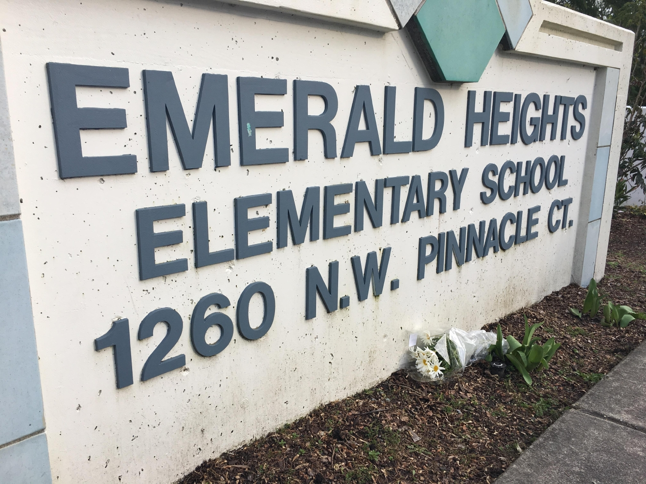 Someone placed a flower bouquet near the front entrance to Emerald Heights Elementary School in Silverdale. (KOMO Photo)