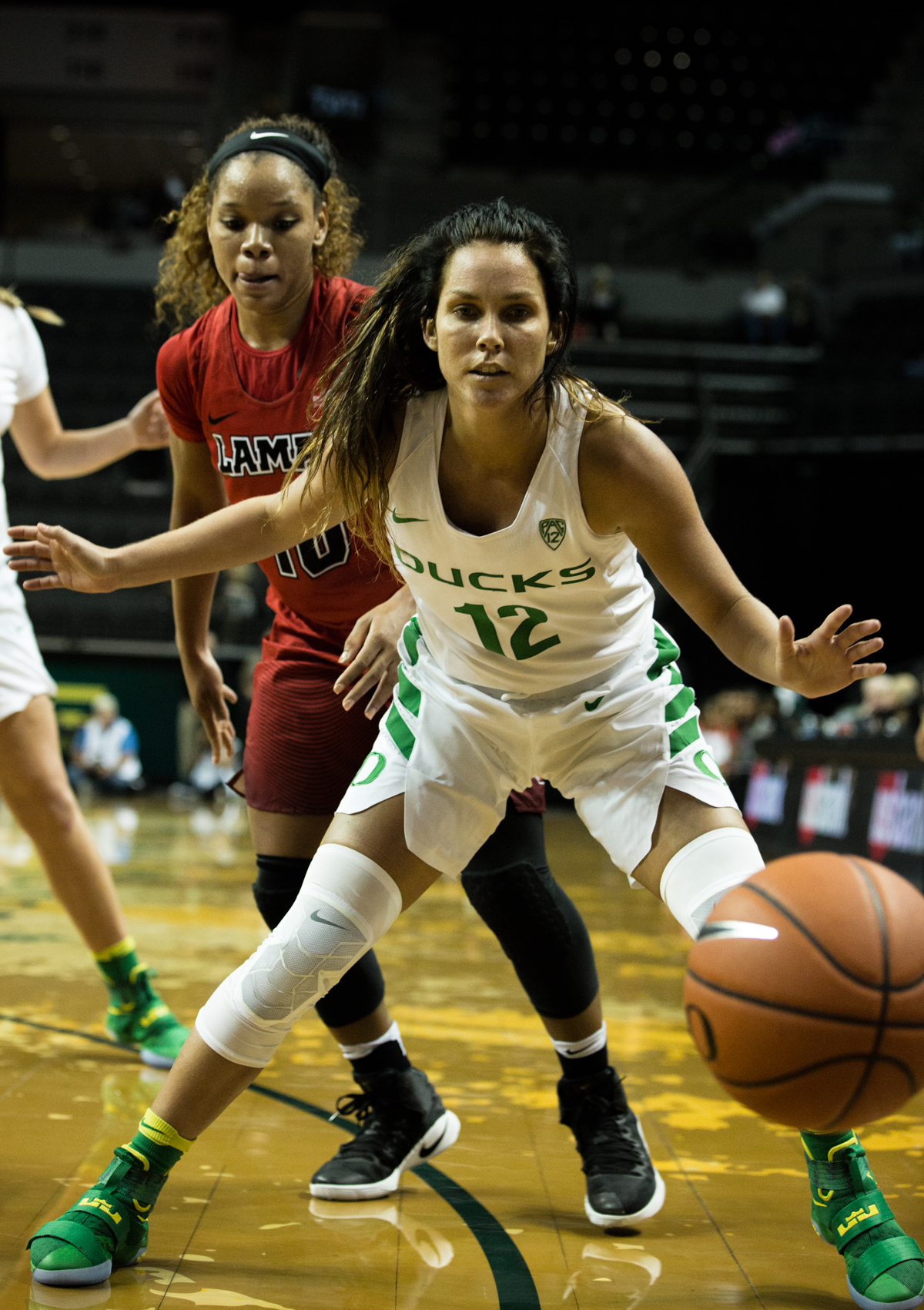 Oregon Ducks guard Megan Trinder (#12) boxes out Cardinals guard Chastadie Barrs (#10). The Oregon Ducks Women's basketball team won their season opener against the Lamar Cardinals 84-67.  Photo by Austin Hicks, Oregon News Lab