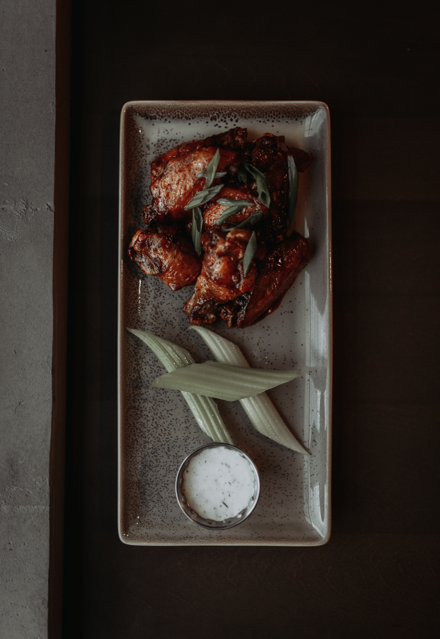 Flash fried chicken wings with honey-gochujang BBQ sauce with bleu cheese dressing / Image: Brianna Long // Published: 5.17.18<p></p>