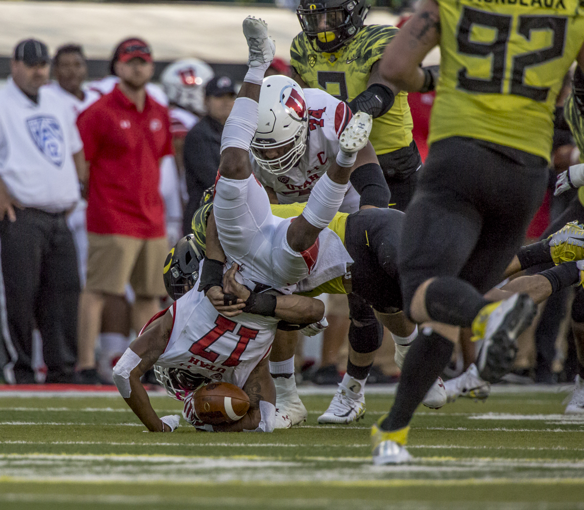 An Oregon defender brings down Utah wide receiver Demari Simpkins (#17). The Oregon Ducks defeated the Utah Utes 41 to 20 during Oregon's homecoming game at Autzen Stadium on Saturday, October 28, 2017. Photo by Ben Lonergan, Oregon News Lab
