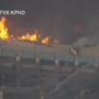 Massive fire causes roof collapse at a grocery store in Phoenix