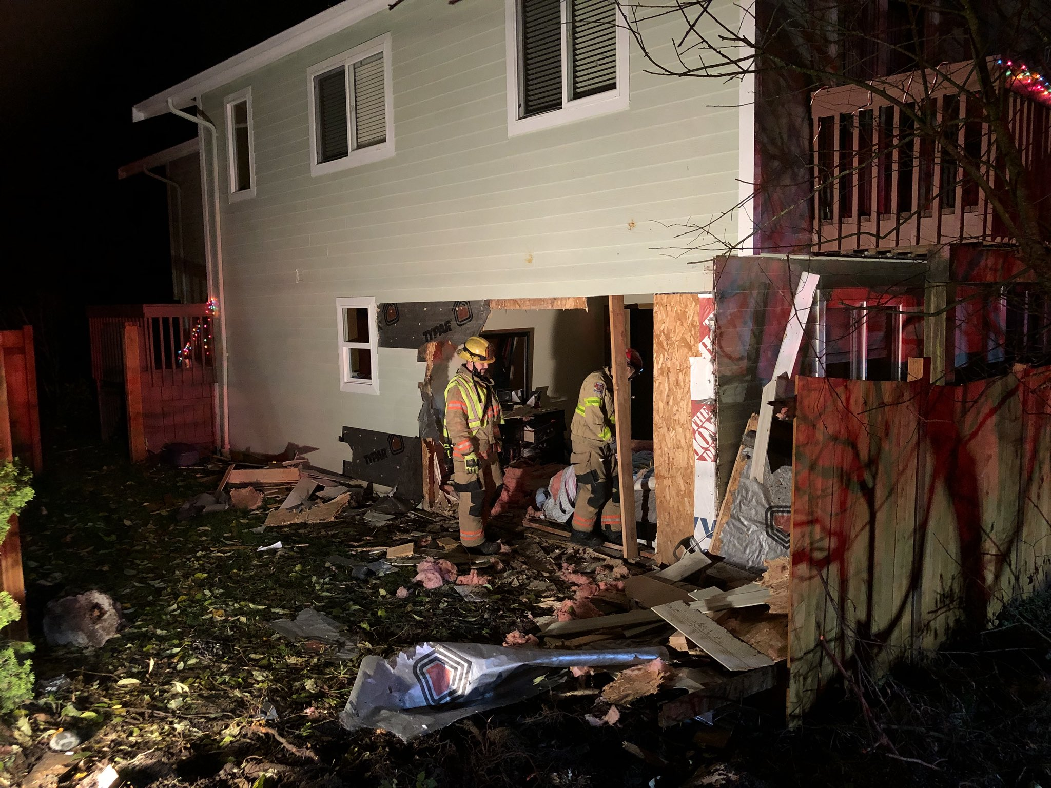 South King Fire and Rescue crews worked to patch up the house after a car drove through one of the walls early Friday morning. (Photo credit: South King Fire and Rescue)<p></p>