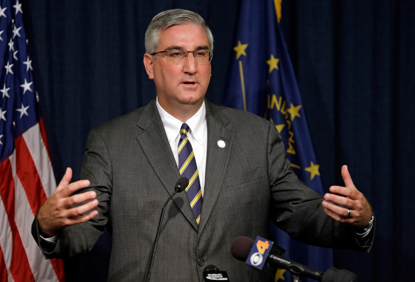 Indiana Lt. Gov. Eric Holcomb discusses the state's fiscal condition following the close of Fiscal Year at the Statehouse in Indianapolis,  (AP Photo/Michael Conroy)
