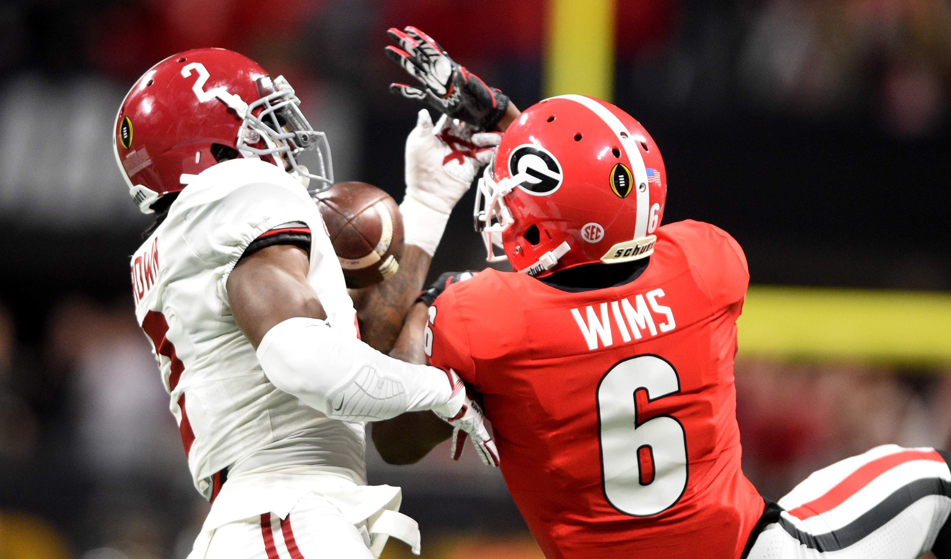 Georgia's Javon Wims, right, can't hang onto a pass that bounces into the arms of Alabama's Tony Brown for the interception early in the first period during the 2018 College Football Playoff National Championship at Mercedes-Benz Stadium in Atlanta, Ga., Monday evening January 8, 2018. MICHAEL HOLAHAN/AUGUSTA CHRONICLE