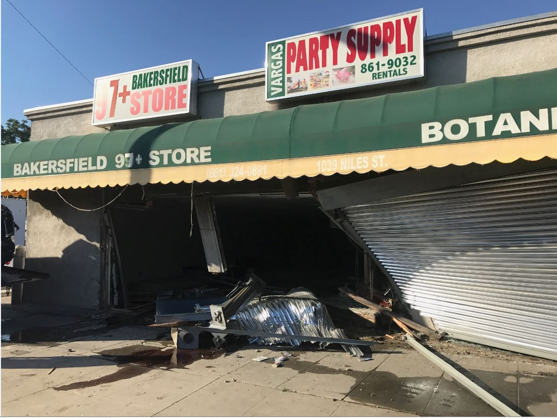 Damage is seen after a truck crashed into a pair of businesses Thursday morning, June 15, 2017 at Niles and Gage streets in Bakersfield, Calif. (Photo from Bakersfield Fire Department)