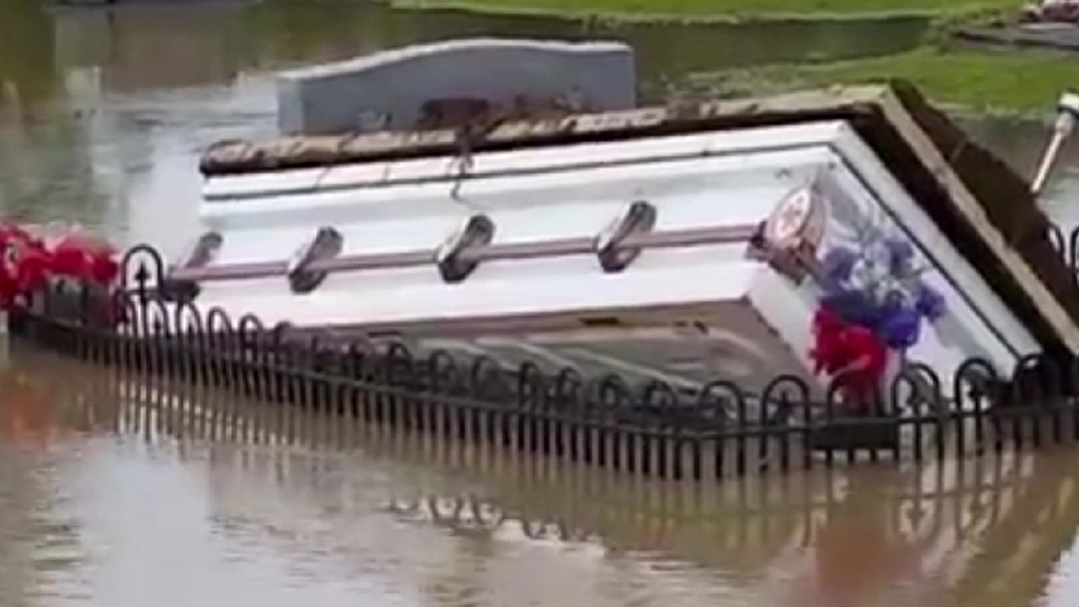 caskets rise from south carolina cemetery after widespread flooding