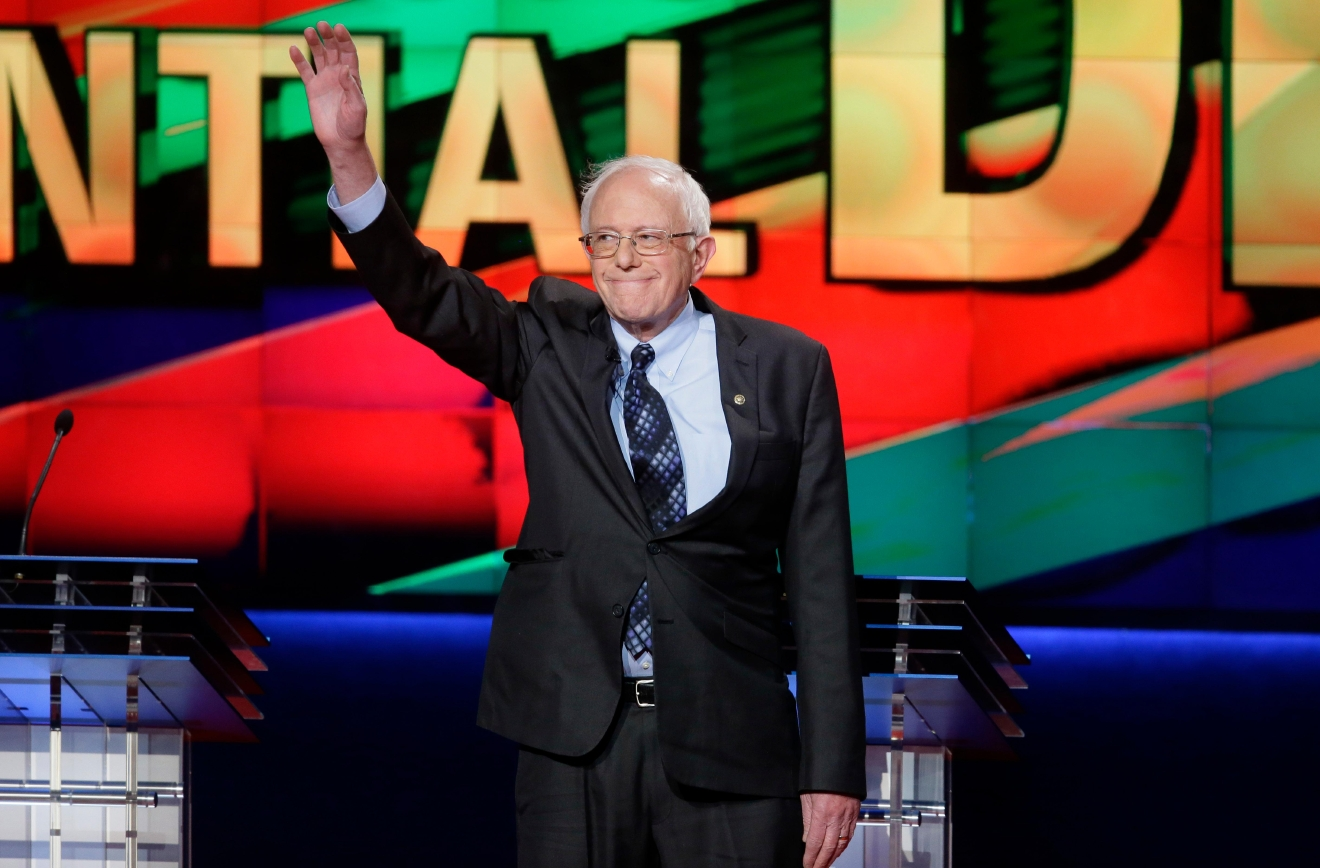 Democratic presidential candidate, Sen. Bernie Sanders, I-Vt., arrives on stage during a Democratic presidential primary debate at the University of Michigan-Flint, Sunday, March 6, 2016, in Flint, Mich. (AP Photo/Carlos Osorio)