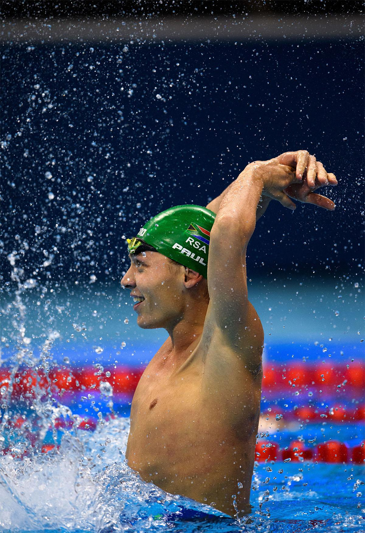 In this photo provided by the IOC, South Africa's Kevin Paul celebrates winning the men's 100-meter breaststroke - SB9 swimming final of the Paralympic Games in Rio de Janeiro, Brazil, Thursday, Sept. 8, 2016. (Bob Martin/OIS, IOC via AP)