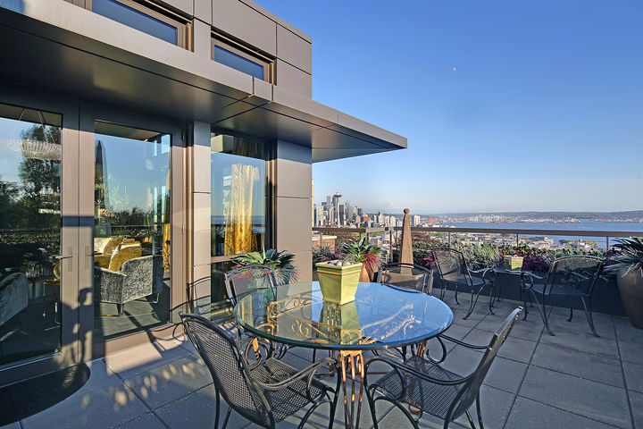 "Nope, this isn't a penthouse in New York City - it's in Queen Anne! This two-bedroom, two-bathroom home has three private terraces, is pet-friendly and has views of{&nbsp;}Kerry Park, Puget Sound, Mt. Rainier and the Olympics. It comes in just under 2,500 square feet and is currently listed for $5 million by Jan Selvar of Windermere.{&nbsp;}<a  href=""https://www.windermere.com/listing/WA/Seattle/200-W-Highland-Dr-502-98119/112399497"" target=""_blank"" title=""https://www.windermere.com/listing/WA/Seattle/200-W-Highland-Dr-502-98119/112399497"">More info online</a>. (Image: Courtesy of Jan Selvar/Windermere Real Estate){&nbsp;}"
