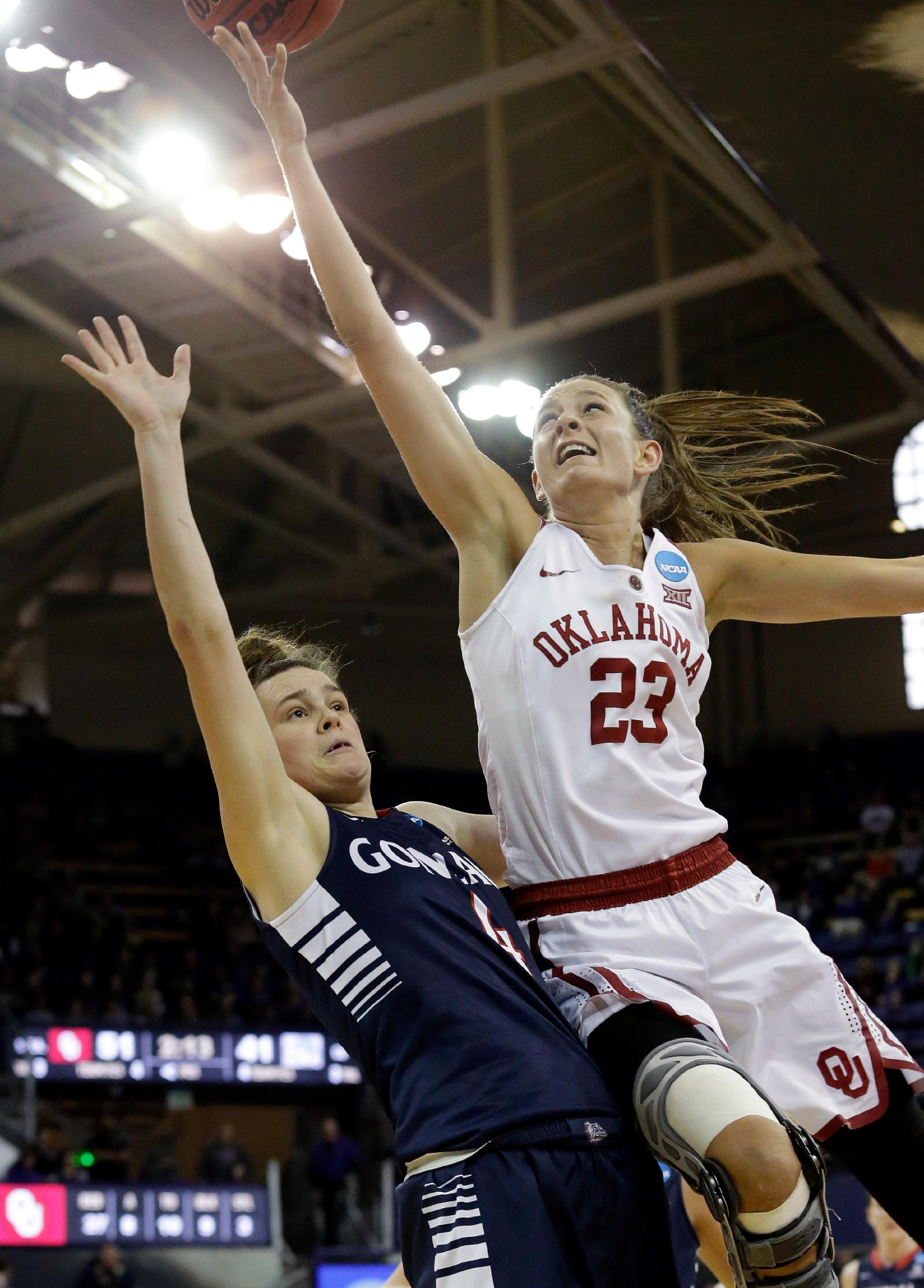 Oklahoma's Maddie Manning (23) collides with Gonzaga's Makenlee Williams during the second half of a first-round game in the NCAA women's college basketball tournament Saturday, March 18, 2017, in Seattle. (AP Photo/Elaine Thompson)