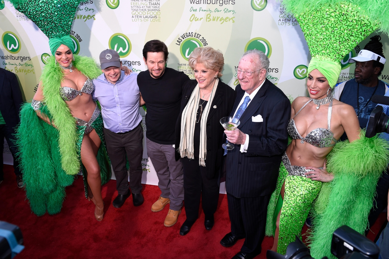 Mark Wahlberg and brother executive chef Paul Wahlberg pose with Las Vegas Mayor Carolyn Goodman and LVCVA Host Committee Chairman Oscar Goodman and showgirls as they arrive at a VIP event at Wahlburgers Las Vegas in the Grand Bazaar Shops at Bally's Tuesday, March 28, 2017. [Sam Morris/Las Vegas News Bureau]
