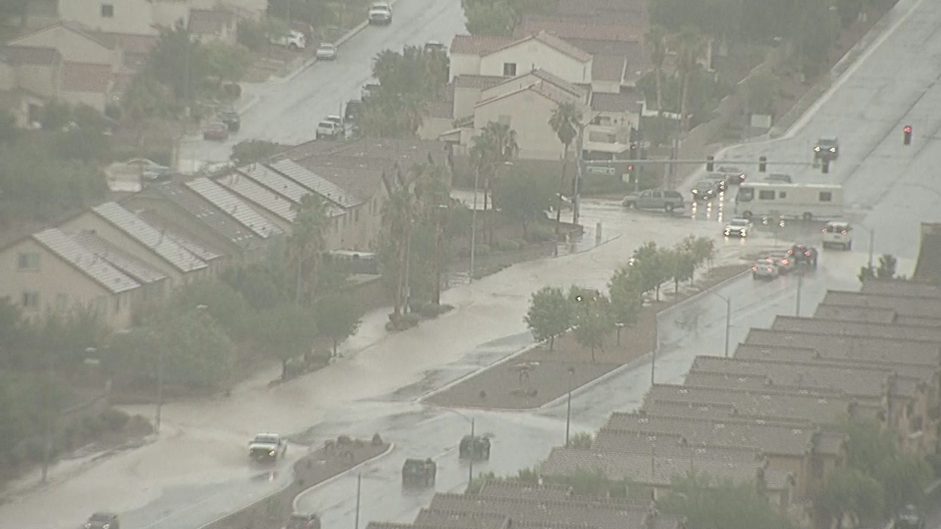 Residents deal with flooding Tuesday, July 25, 2017, in the northwest Las Vegas valley. (Tom Hawley/KSNV)