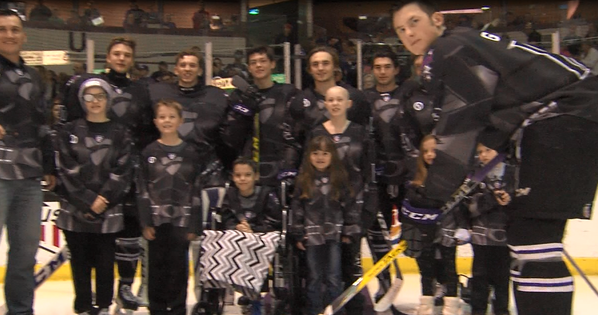 Sammy's Superheroes partake in a ceremonial puck drop before the Tri-City Storm game on March 18, 2017 at the Viaero Center (NTV News)