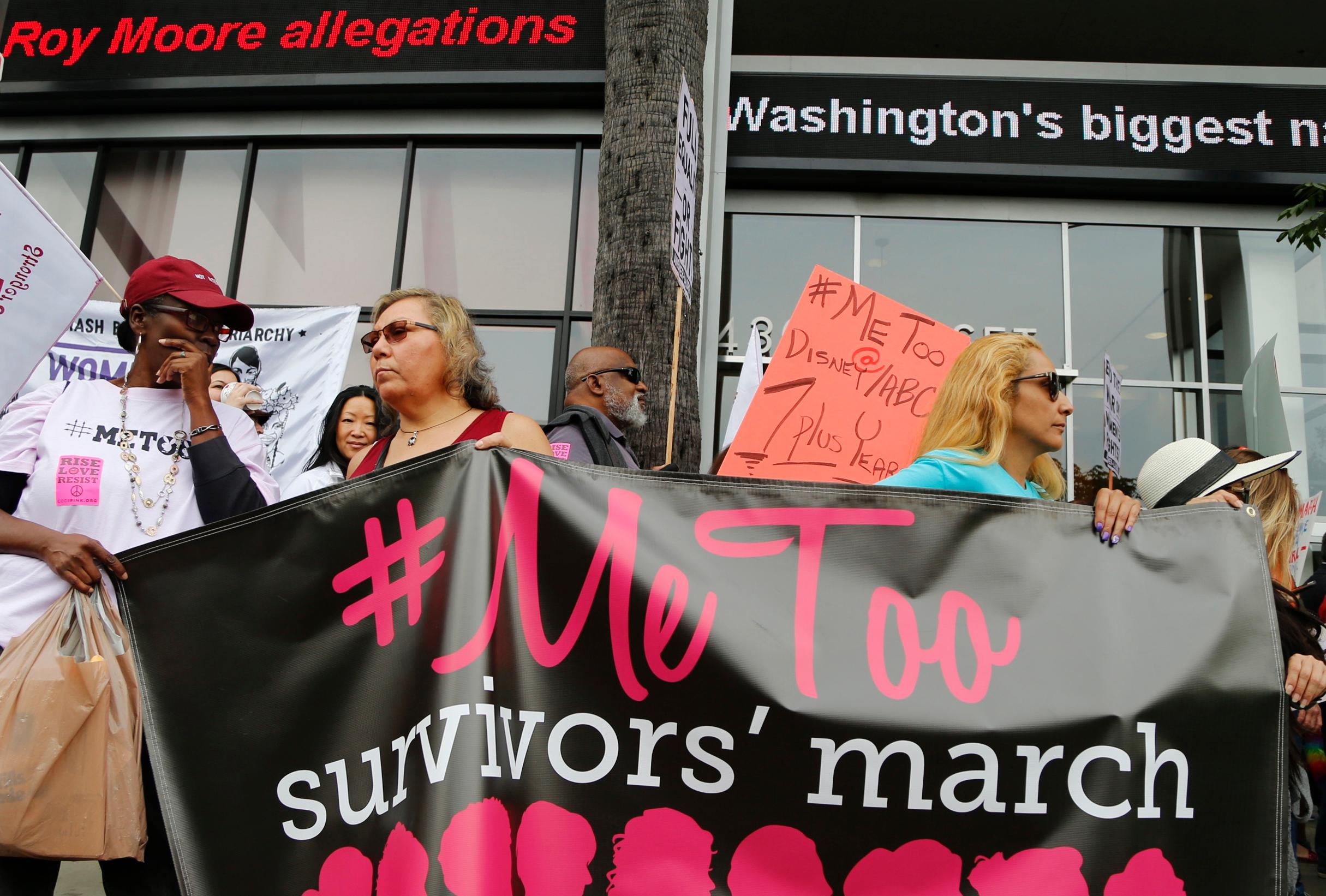 Participants rally outside the Cable News Network's Hollywood studios on Sunset Boulevard to take a stand against sexual assault and harassment for the #MeToo March in the Hollywood district of Los Angeles on Sunday, Nov. 12, 2017. (AP Photo/Damian Dovarganes)
