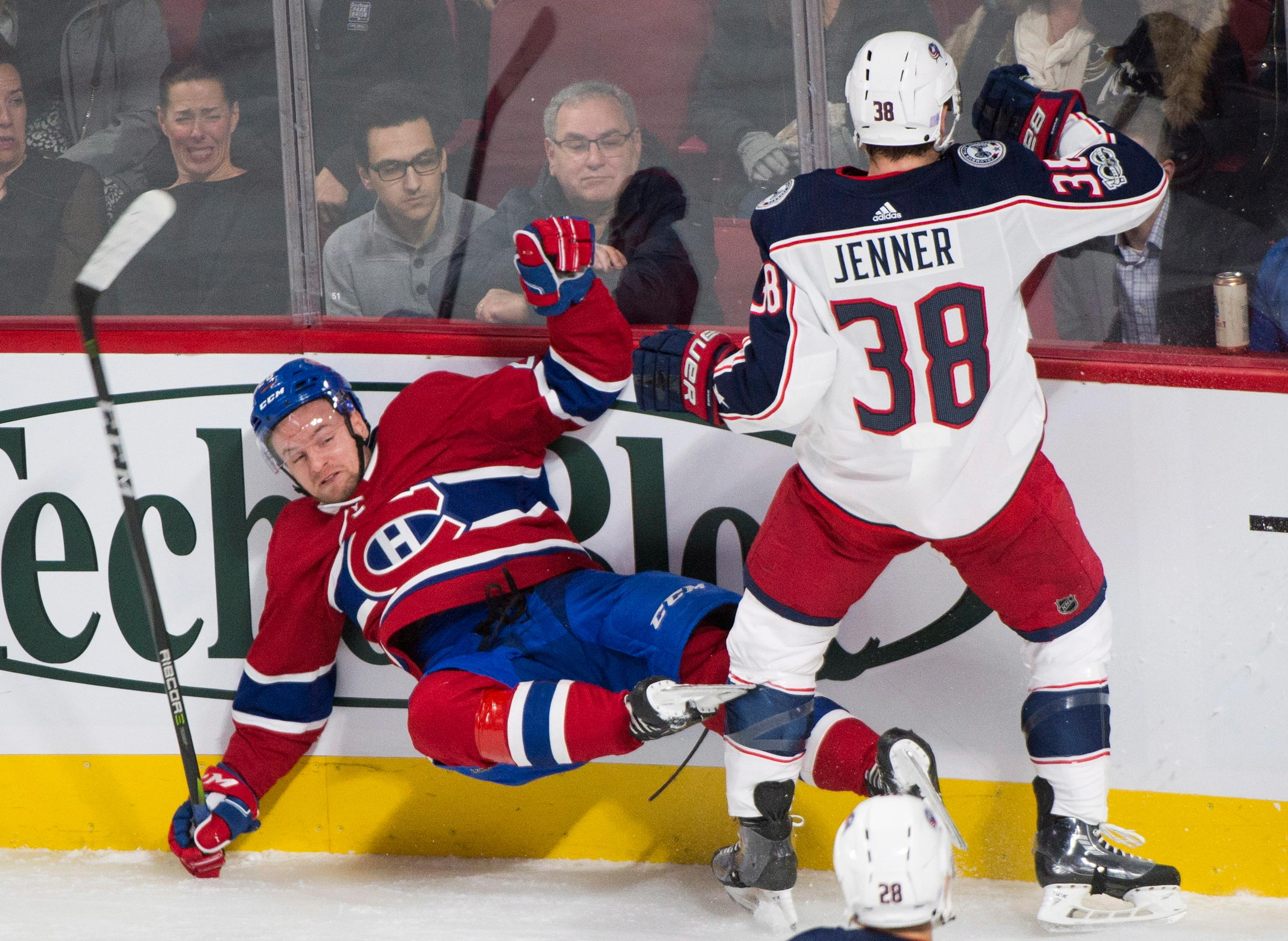 Montreal Canadiens' Jakub Jerabek is checked into the boards by Columbus Blue Jackets' Boone Jenner during first period NHL hockey action in Montreal, Monday, Nov. 27, 2017. (Graham Hughes/The Canadian Press via AP)