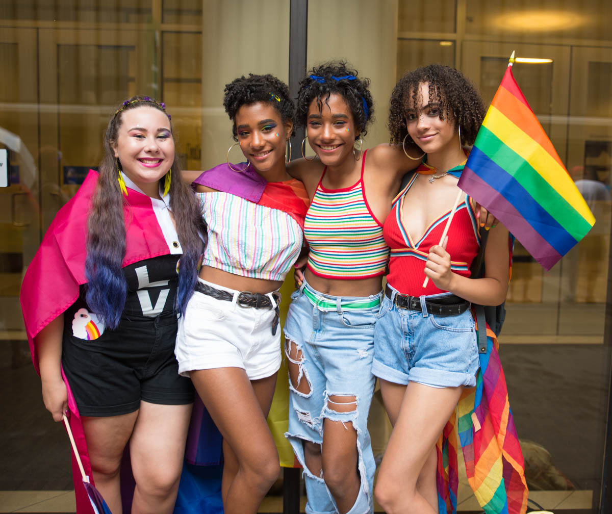 "Lilyana Cornett, Reagan Holtzman, Maya Holtzman, and Nina Leon at this year's Pride parade that took place in Downtown Cincinnati. First published on June 24 in ""Photos From The 2018 Cincinnati Pride Parade"" / Image: Sherry Lachelle Photography"