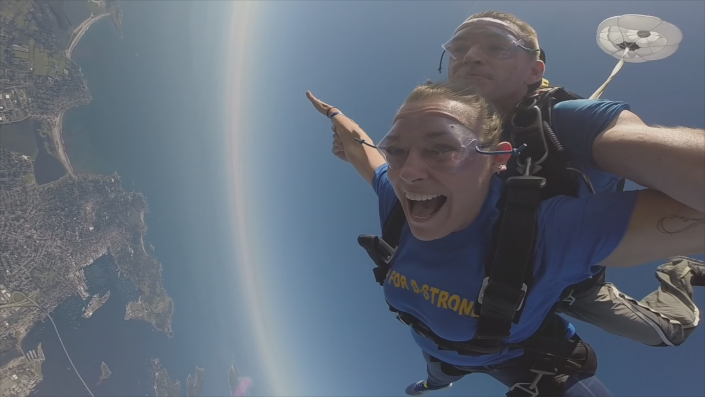 Melissa Murray and an instructor at Skydive Newport jump in support of Dorian Murray Foundation. (WJAR)