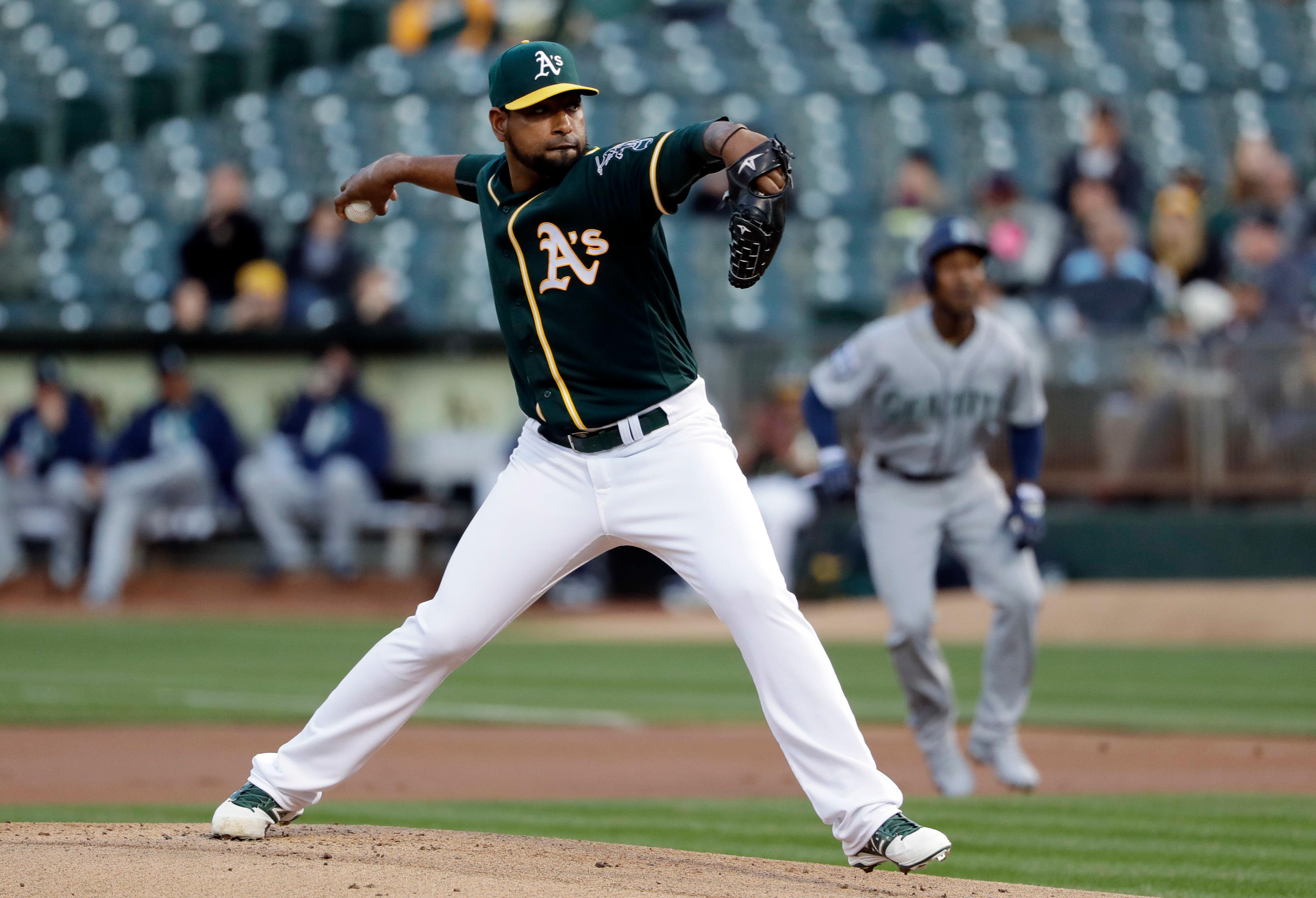 Oakland Athletics starting pitcher Cesar Valdez throws to the Seattle Mariners during the first inning of a baseball game Thursday, April 20, 2017, in Oakland, Calif. (AP Photo/Marcio Jose Sanchez)
