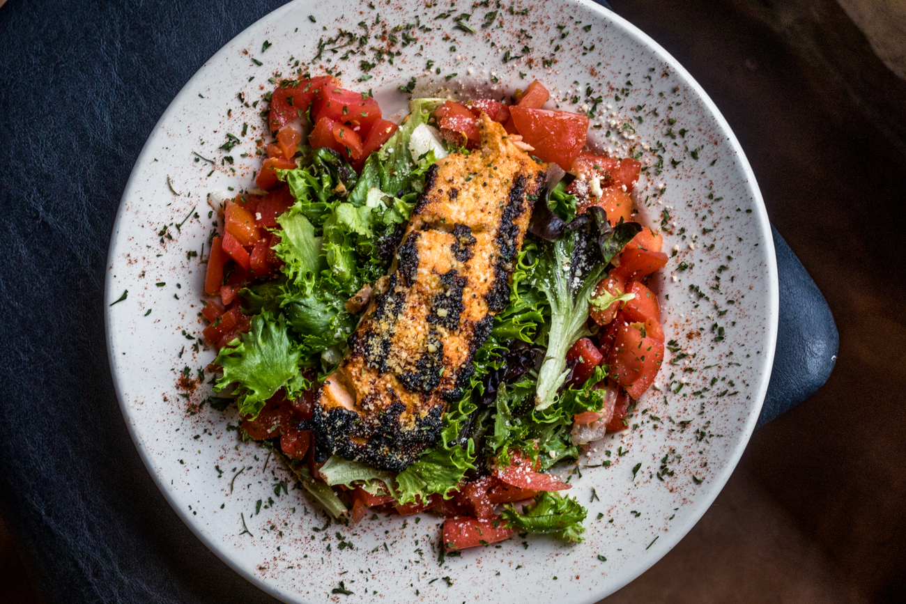 Grilled Salmon Salad with tomatoes and crusted in parmesan cheese / Image: Catherine Viox // Published: 8.10.20