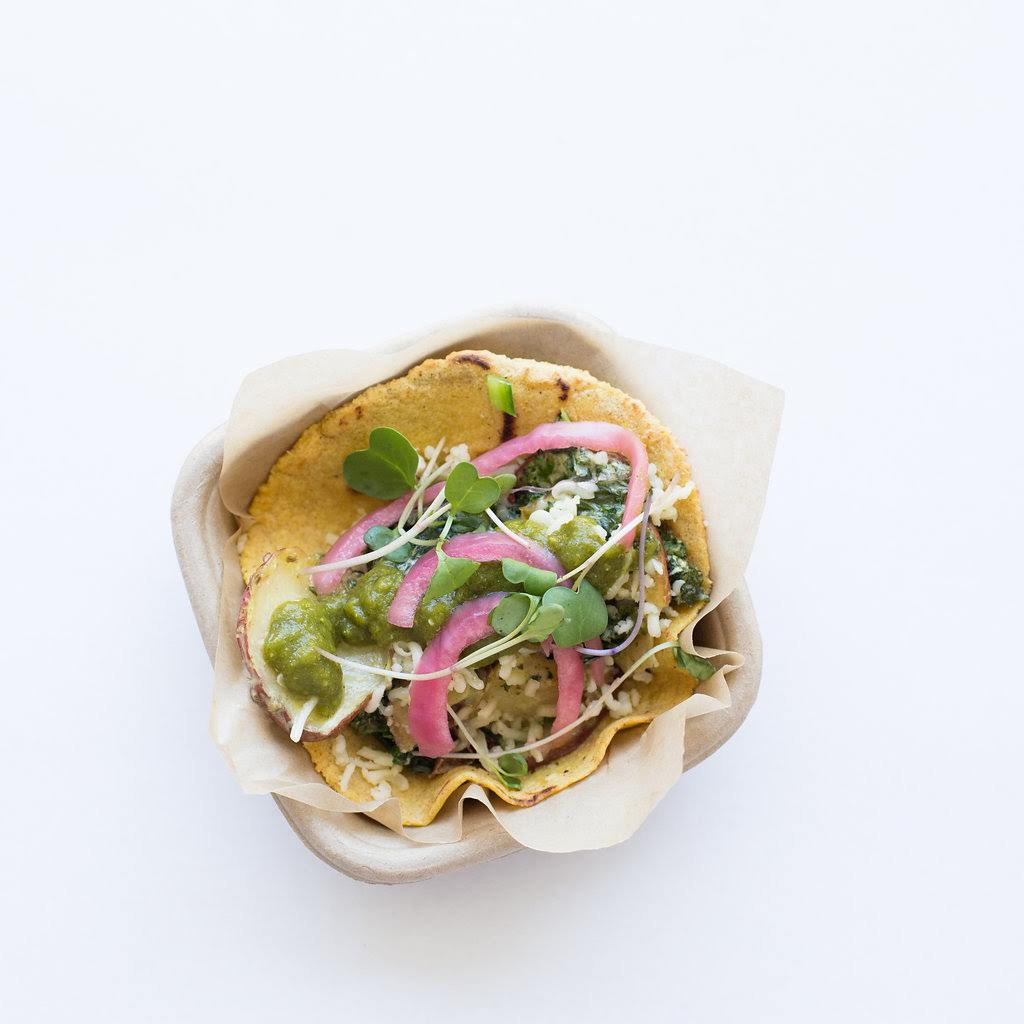 Served in a homemade grilled corn tortilla, it features roasted red skin potatoes and sautéed dark leafy kale tossed with an ultra creamy roasted poblano sauce.  It comes garnished with pickled red onions, salsa verde, and pepper jack cheese. (Image: Courtesy Chaia)