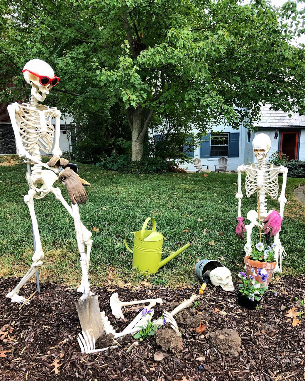 "Christy says she inherited the ""Halloween gene"" from her mom and aunt, who also live in Northern Kentucky and put on a similar display. Instead of skeletons though, Christy's mom poses a pair of werewolves. / Image courtesy of Mark & Christy Walker // Published: 10.31.19"