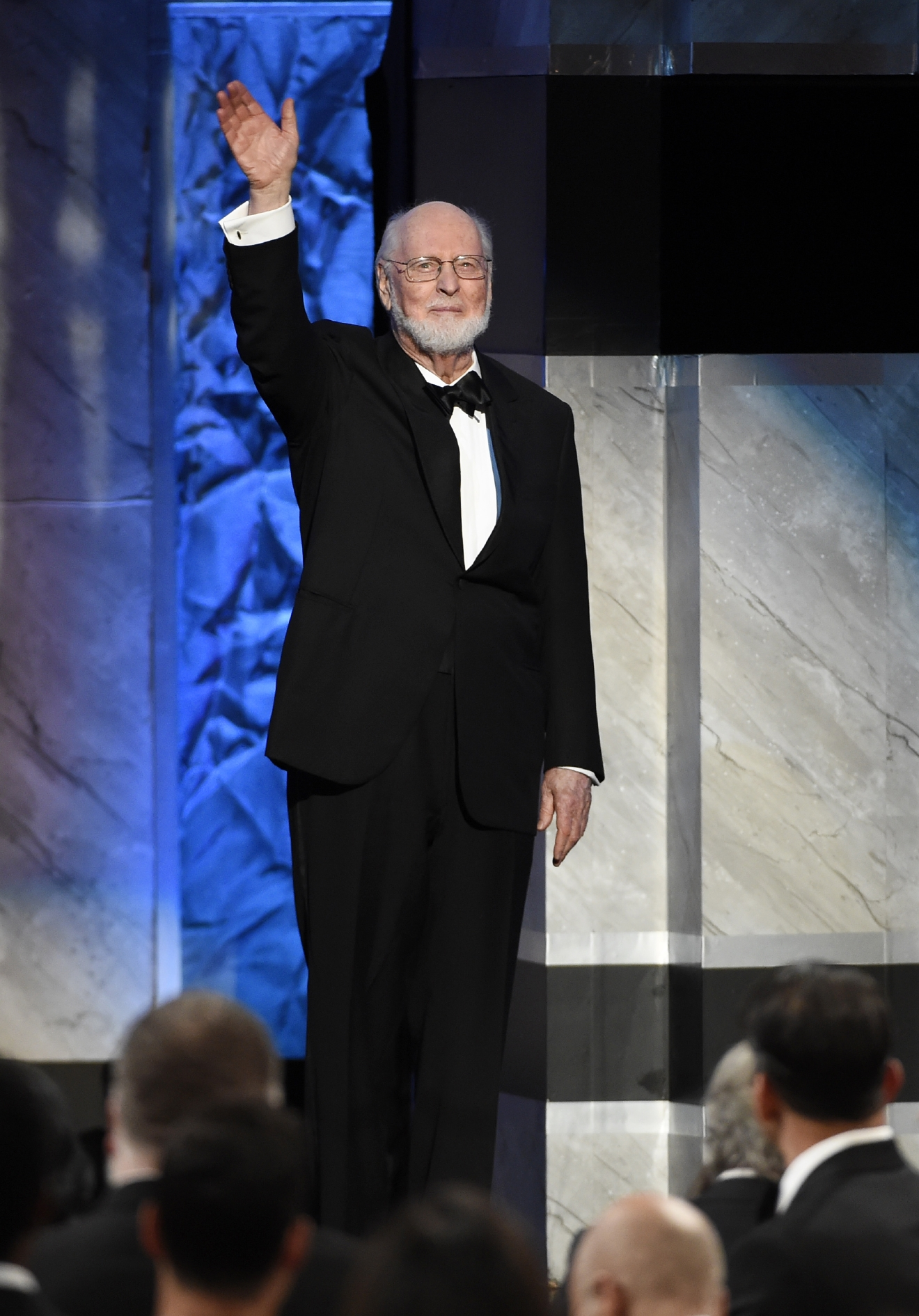 Composer John Williams waves to the audience as he is introduced onstage during the 2016 AFI Life Achievement Award Gala Tribute to Williams at the Dolby Theatre on Thursday, June 9, 2016, in Los Angeles. (Photo by Chris Pizzello/Invision/AP)
